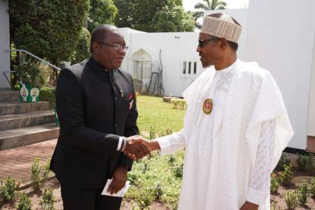 Kole in handshake with President Buhari